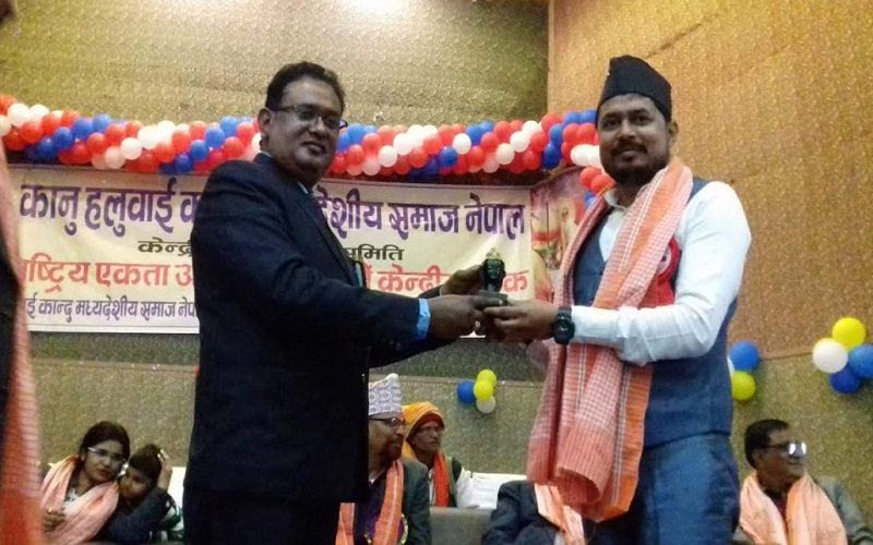 Sandeep Gupta ji received honor by Mr. R.B. Shah in Nepal on the stage of kanu halwai kandu madheshiya samaj nepal.
